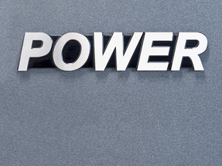 "metal word ""POWER"" on grey background"