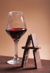 Red wine glass and chocolate pyramid