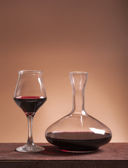 Red wine glass and filled decanter