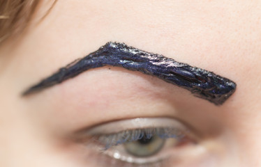 painted black eyebrows
