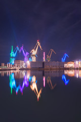 Illuminated cranes at shipyard in Pula