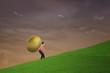 Businessman carry golden egg on steep hill