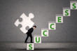 Businessman carry puzzle piece to gain success