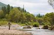 Fly fisherman fishing in mountain river - 80612620