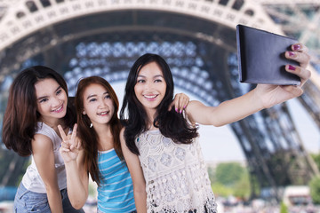 Group of casual girls taking self picture
