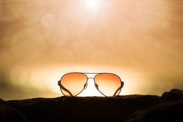 Sunglasses at Sunset and Rays of Sunlight