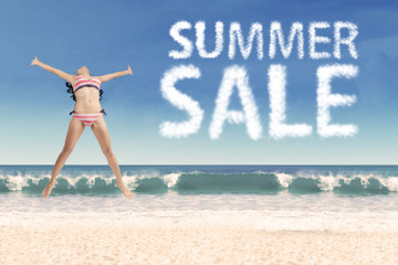 Joyful girl with summer sale cloud