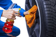 Mechanic cleaning a tire rim - 80613638