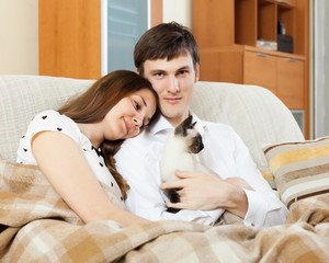 couple with kitten in living room