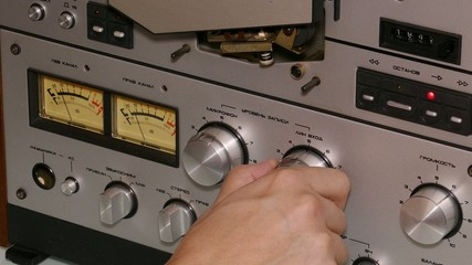 hand man operates reel tape recorder - 4k