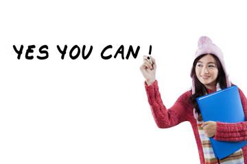 Schoolgirl in winter clothes write advice words