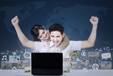 Successful couple with online business on blue world map
