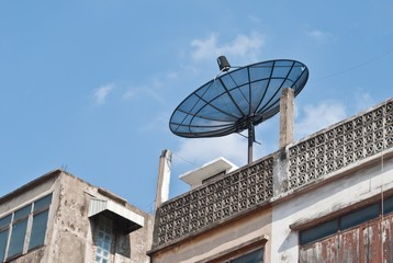 old buildings tower and satellite dish
