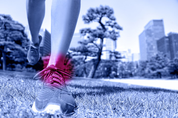 Sports injury - runner feet with ankle pain