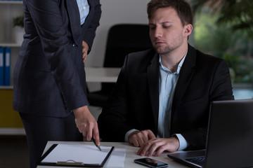 Man and his boss at work