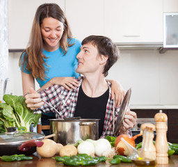 Couple together cooking