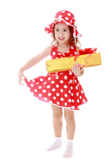 Girl in summer red polka dot dress holding a gift