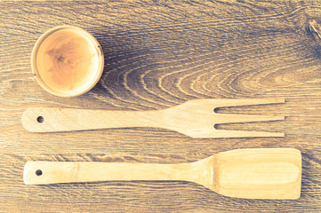 Wooden spatula, fork and cup