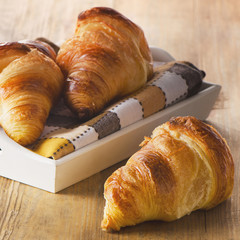 Croissants on a  wooden background