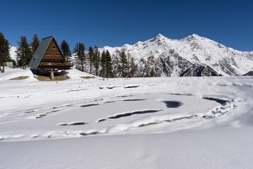 frozen lake in high mountain on italian Alps, Gressoney, Italy.