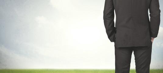 Businessman with meadow