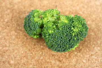 Broccoli Close Up on a Brown Background