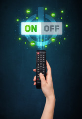 Hand with remote control and on-off signals