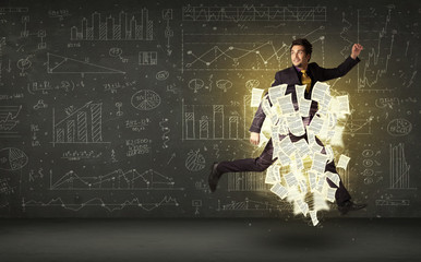 Handsome businessman jumping with paper document cloud