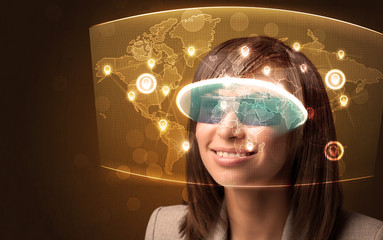 Young woman looking at futuristic social network map
