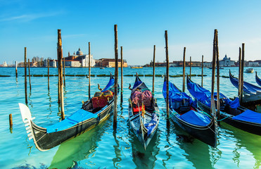 Venice with gondolas on Grand Canal against San Giorgio Maggiore