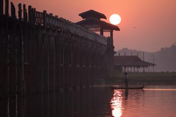 U bein bridge and Taungthaman lake with boat in Amarapura, Myanm