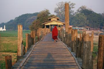 Unrecognized Buddhist monk walking on U Bein Bridge