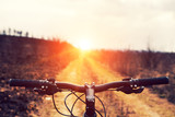 Mountain biking down hill descending fast on bicycle. View from