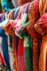Various colorful scarves hanging at street bazaar in Istanbul