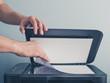 Leinwanddruck Bild - Hands of a man copying a piece of paper