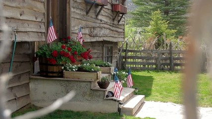 Front Porch of Home with American Flag