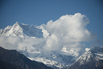 Clouds over the snowcapped mountains, Himalayas, Uttarakhand, In