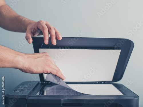 Leinwanddruck Bild Hands of a man copying a piece of paper