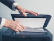 Leinwanddruck Bild - Hands of businessman copying document