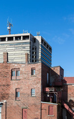Modern Tower Behind Old Brick Building