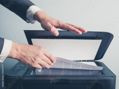 Leinwanddruck Bild Hands of businessman copying document