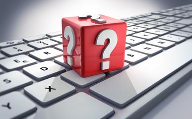 Würfel mit Fragezeichen auf Keyboard