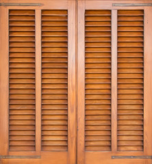 Window with brown shutters. Close-up view.