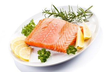 Fresh raw salmon steak on white background