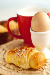 yummy breakfast with croissants and eggs