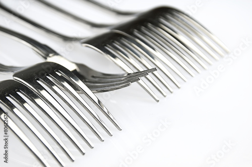 Forks arranged in series on the kitchen table. - 80622678