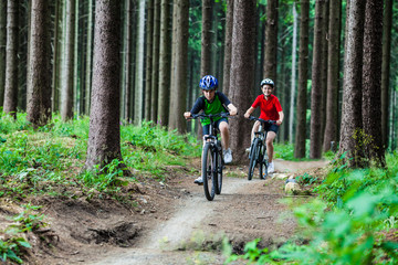 Healthy lifestyle - teenage girl and boy biking