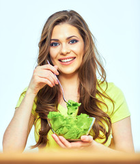 woman eating salad with pleasure.
