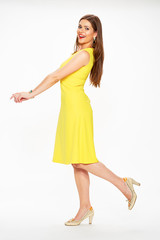 Fashion woman in yellow dress.