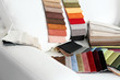 Leinwandbild Motiv Scraps of colored tissue on sofa close up